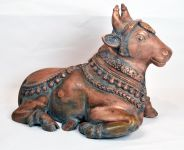 An Indian Copper Carved Seated Cow Statue