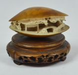 A Japanese Carved Ivory Clam with Stand