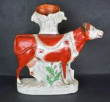 A Staffordshire Cow Flatback Figure Spill Vase