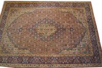 A Persian Tabriz Hand Knotted Wool Rug